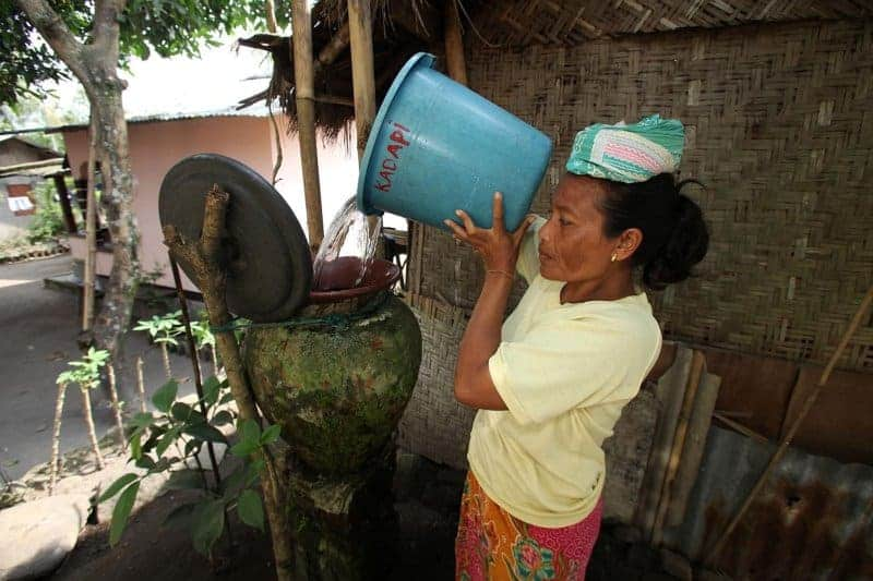 lady pouring clean water
