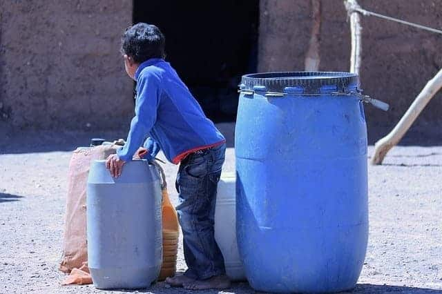boy with water barrels & 16 Best Water Storage Containers for Long Term and Emergency Supply ...